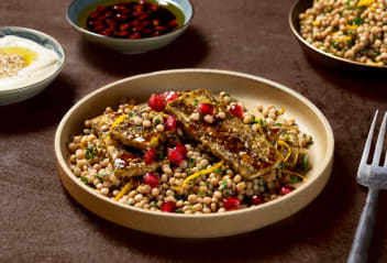 Za'atar Tofoumi with Orange Couscous, Tahini & Pomegranate Dressing
