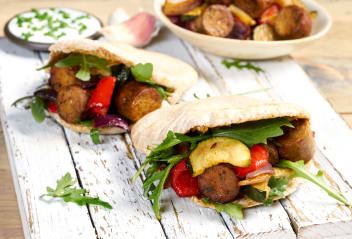 Hot Sausage Pittas with Roasted Vegetables & Garlic Dressing