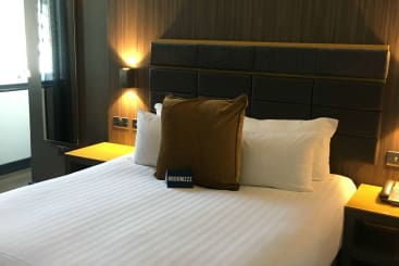 The bedroom of a neo suite at Manchester Corn Exchange