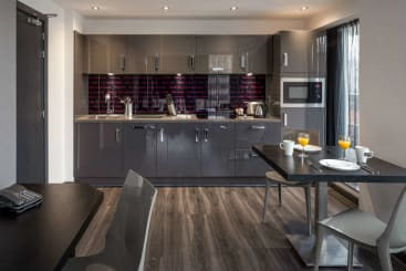 The kitchen in the penthouse at Roomzzz Nottingham City