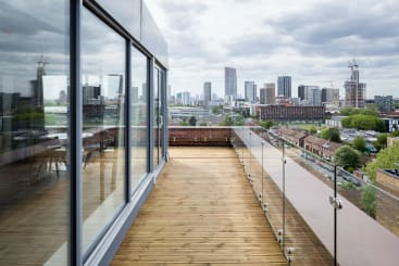 The rooftop balcony in the dezign suite at Roomzzz London Stratford