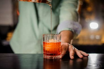 an old fashioned drink from the alchemist