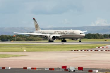 An Ethihad plane on the runway at Manchester Airport