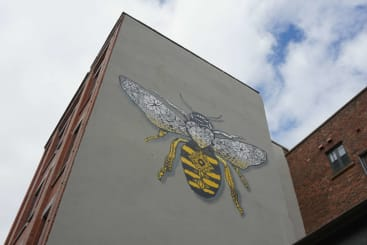Street art of a worker bee in Manchester's Northern Quarter