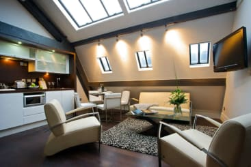 The lounge and dining area of the emperor suite in Manchester city Roomzzz