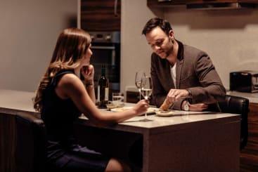 couples enjoying dinner in apartment