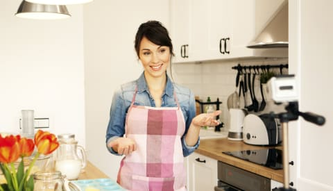 Woman ready to get cooking in the kitchen