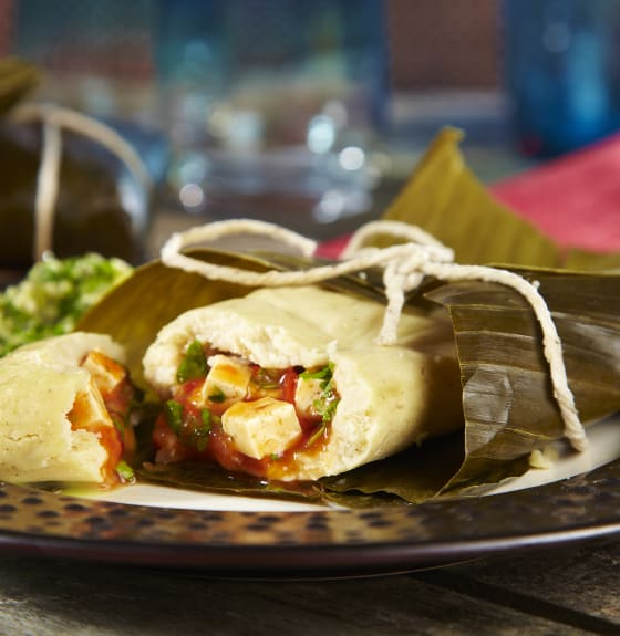 Tamales with salsa roja