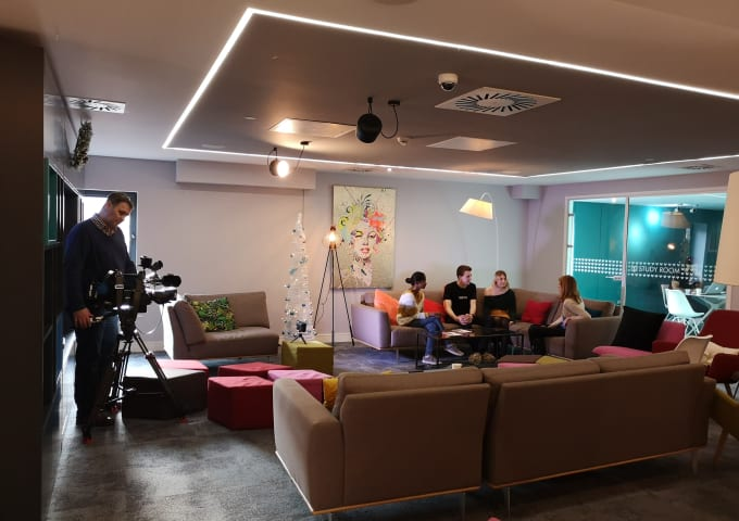 IconInc residents talking to a BBC reporter in the communal lounge.