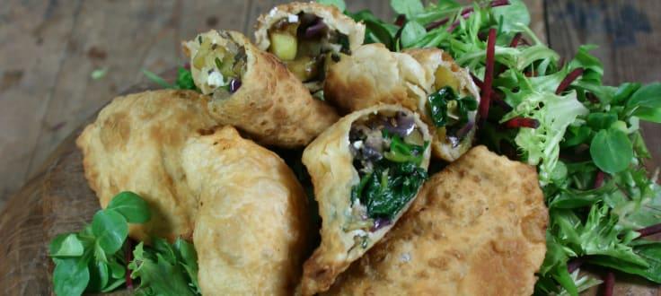a beautiful dish of Fresh Rootz Cauldron Empanada